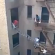 Video un Edificio quemandoce mujer casi muere Neighbor Uses House Ladder To Save A Life In 8 Stories NY Building From Fire Escape